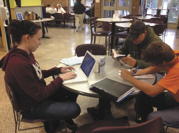 Clockwise from left, Haley Sandoe, Ryan Shelmire and David Manikowski study Tuesday at Penn State Mont Alto. The college added expiration dates to its ID cards to comply with a new voter law in Pennsylvania.