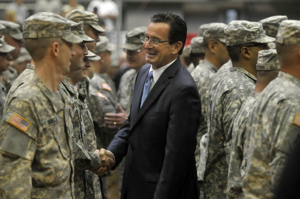 Gov Dannel P. Malloy shakes hands with the troops after the ceremony.