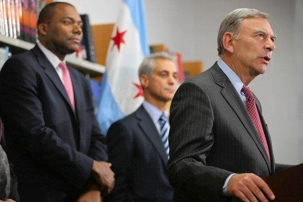 Chicago schools CEO Jean-Claude Brizard, from left, Mayor Rahm Emanuel and school board President David Vitale make a statement Tuesday after the teachers union agreed to end its strike.