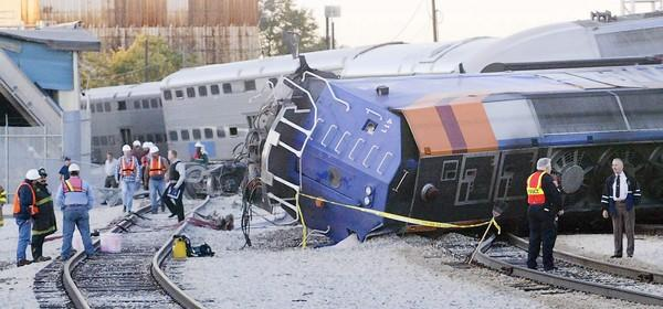 Kathryn Kuk, who suffered multiple injuries in a 2003 derailment on the South Side, settled a lawsuit with Metra for $1.8 million, her attorney said Tuesday.