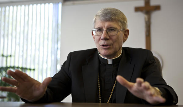 Bishop R. Daniel Conlon holds a press conference last year.