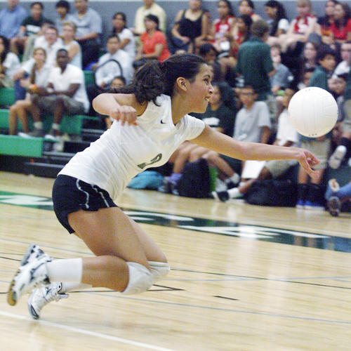 Providence's libero Lorena Ubillus leaps for a deep ball by Bell Jeff.