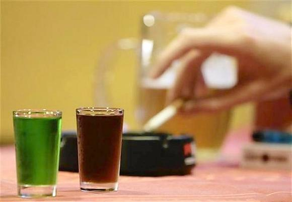 Shots of liquor are seen at a bar