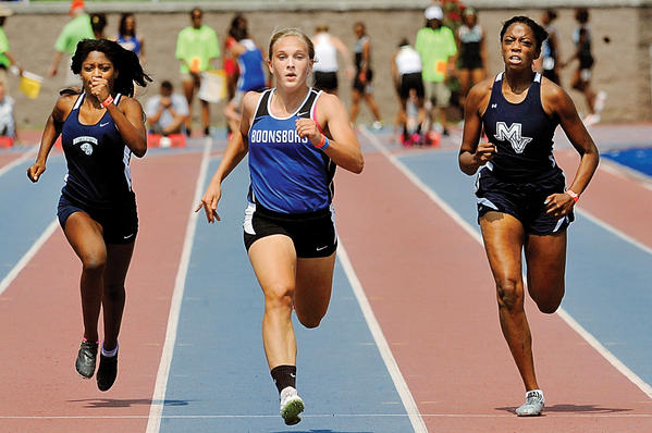 Boonsboro's Abby Duncan, center, sprints to victory in the Class 1A girls 100-meter dash at the Maryland state meet in Baltimore last May.