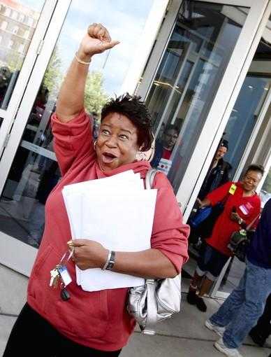 A jubilant Stephanie Hayes pumps her fist after the Chicago Teachers Union ended its strike on Tuesday.
