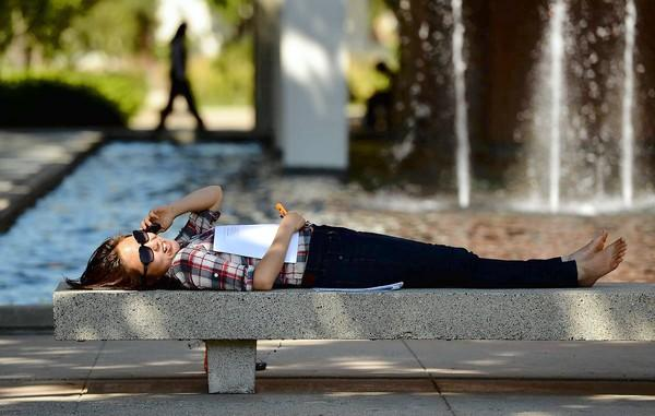The 5% tuition hike — equal to $150 per semester — would raise an estimated $58 million in revenue in fiscal 2012-13, officials said. Above, graduate student Joan Lim relaxes at Cal State Long Beach.