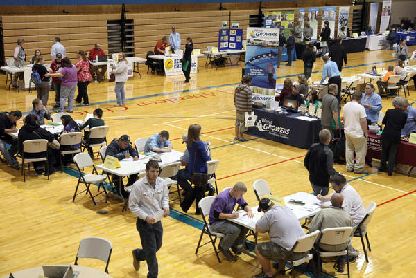 Area employers and those seeking jobs moved about at Tuesday's Aberdeen Area Job Fair at the Aberdeen Civic Arena. American News Photo by John Davis