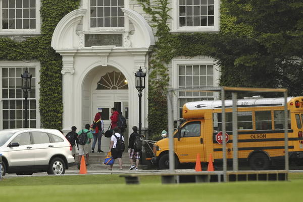 Students enter Lake Forest High School Monday, Sept. 17, 2012 during a teacher strike as teachers picketed outside the school.