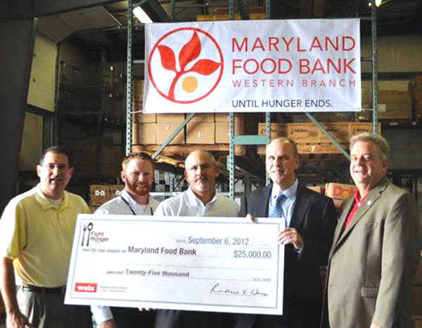 Among those attending a Sept. 6 ceremony during which the Maryland Food Bank accepted a $25,000 donation from Weis Markets were, from left, Sen. Christopher B. Shank, R-Washington; Matt Thompson, executive director of the Maryland Food Bank - Western Branch; John May, senior vice president of operations for the Maryland Food Bank; Dennis Curtin, director of public relations for Weis Markets; and Jeffrey A. Cline, Washington County commissioner.