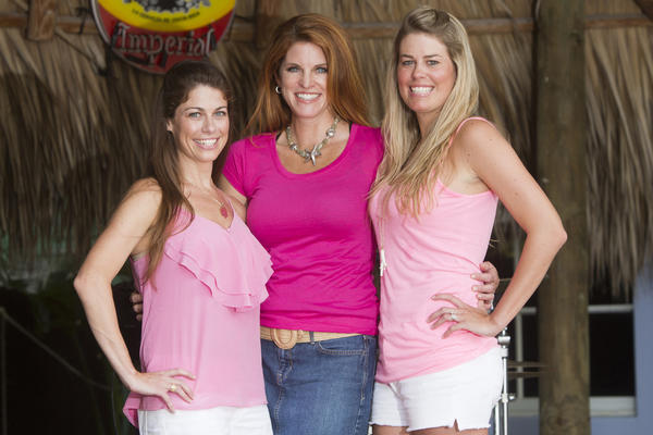 "Shannon Perez, left, Michelle Bussert and Chelsea Lasater at a photo shoot in preparation for the fourth annual ""Bluewater Babes Fish For A Cure,"" presented by Grand Slam Tackle & Marine Center and the Square Grouper Tiki Bar, which takes place on Oct. 5 and 6 at the Square Grouper Tiki Bar located in Jupiter. The event is a women's fishing tournament which raises money for two local charities: H.O.W. - Hearing the Ovarian Cancer Whisper and Cancer Alliance of Help & Hope."