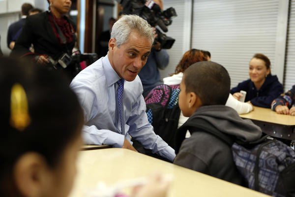 Mayor Rahm Emanuel chats with 10-year-old Nicolas Labellarte in the cafeteria at Frederic Chopin Elementary School in Chicago on the first day back to school following the teachers strike.