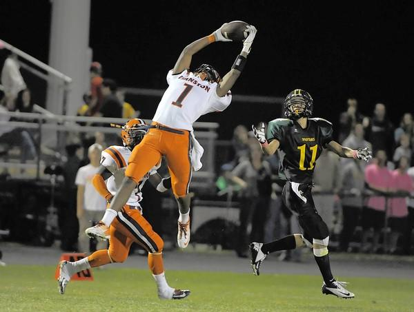 Evanston's Raymond Lackey makes a leaping interception of a pass intended for Glenbrook North's Alex Zera. Glenbrook North hosted Evanston on Fri., Sept. 14, 2012, at Glenbrook North High School in Northbrook, Ill.