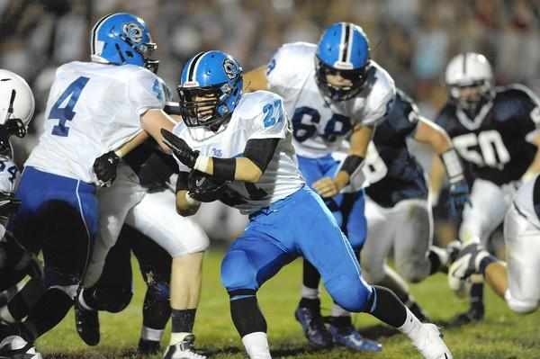 Lake Zurich's Joey Holtz (27) makes headway, Friday, at Cary-Grove.