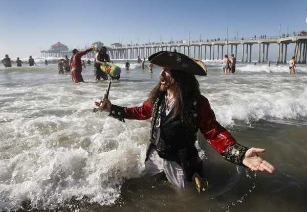 A pirate (Michael Kane, of Costa Mesa) in the surf at Huntington Beach.