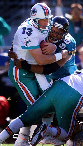 Dan Marino is sacked by Jaguars DT Gary Walker in the second quarter in this undated photograph.