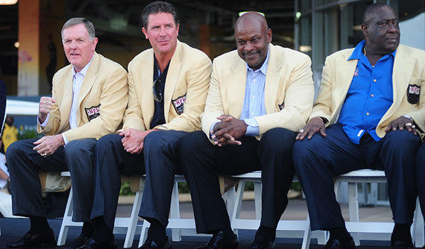 Miami Dolphins Hall of Famers Bob Griese, left, Dan Marino, second from left, Dwight Stephenson, third from left, and Larry Little, right at Sun Life Stadium before the game against the New England Patriots, Monday, Sept. 12, 2011, in Miami Gardens, during the dedication of Joe Robbie Plaza.