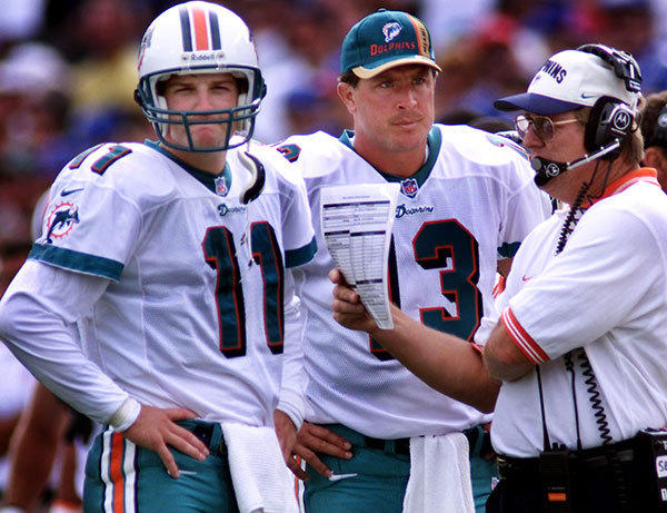 Miami Dolphins at New England Patriots in 1999. Miami qb's Damon Huard, left, and Dan Marino go over offensive plays with assistant coach Larry Seiple Sunday afternoon in Foxboro.