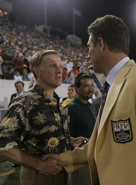 Veteran Hall of Fame QB Bob Griese, left, is greeted by recent inductee Dan Marino after a halftime ceremony honoring this year's inductees Monday Aug. 8, 2005 at Fawcett Stadium where the  Miami Dolphins preseason against the Chicago Bears in the Hall of Fame game in Canton, Ohio.