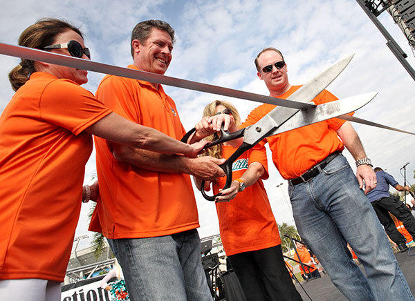 Dan Marino, center, next to Dolphins GM Jeff Ireland, and their wives, cut the ribbon before the beginning of the Dan Marino Foundation Walkabout Autism event in Sunlife Stadium on January 28, 2012.