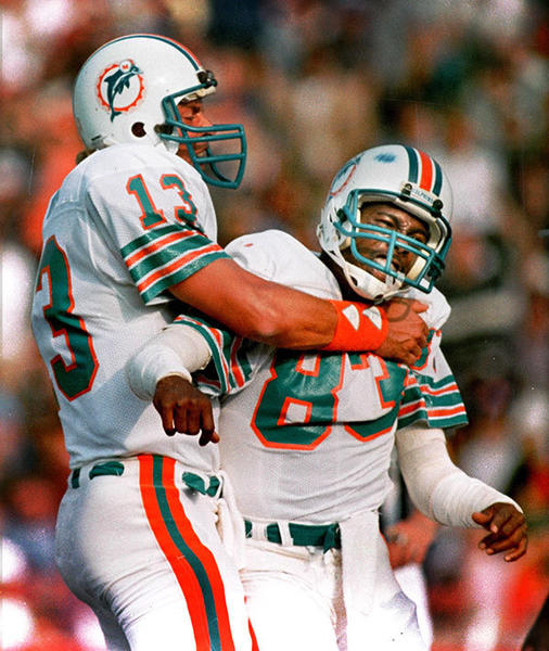 Dan Marino hugs teammate Mark Clayton after a touchdown in New England in 1984.