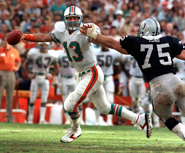 1984 game vs. Oakland Raiders  at Miami's Orange Bowl. Howie Long  tries to tackle Dan Marino who escaped. Both are hall of famers now.