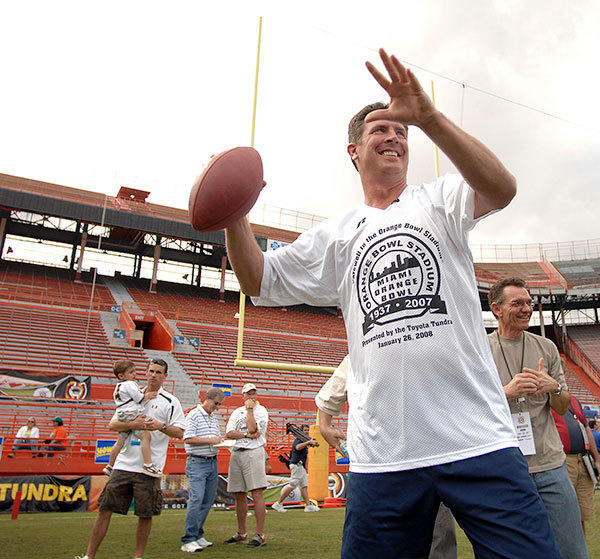 "Dolphin hall of famer Dan Marino throws some warm up passes before the flag football game vs Canes alumn. During the ""Farewell To The Orange Bowl""."