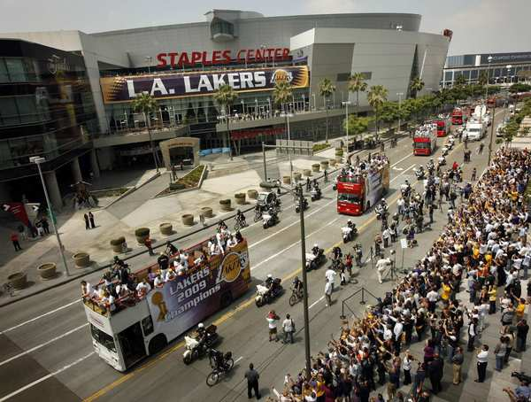 The L.A. Lakers travel past Staples Center during the team's victory parade in June 2009. AEG holds a minority stake in the Lakers.