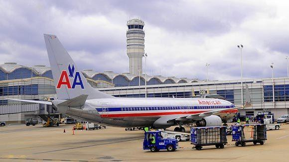 An American Airlines jet sits at the terminal at Ronald Reagan Washington National Airport in Washington, D.C. in 2009 file photo.