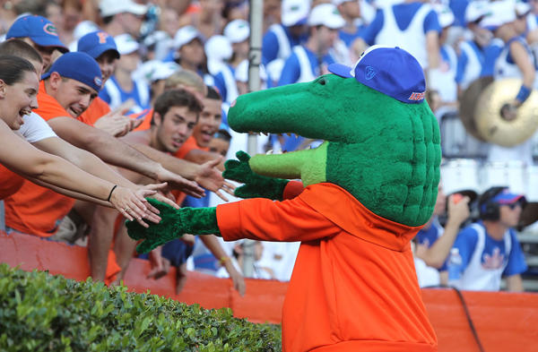 Florida Gators mascot Albert high-fives fans during the second half against the Bowling Green Falcons at Ben Hill Griffin Stadium. Florida Gators defeated the Bowling Green Falcons 27-14.