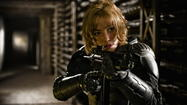 "The time-killing carnage in ""Dredd 3D"" can be assessed all sorts of ways. One depends on how much M-rated gaming you do as a matter of course. If the answer is some, or a lot, you'll likely find ""Dredd 3D"" up your viscera-strewn alley, because the film isn't merely influenced by a genre of first-person, shoot/stab/eviscerate/these/anonymous/enemies scenarios. It re-creates them, slavishly, as did the recent ""The Raid: Redemption,"" so that calling ""Dredd 3D"" a movie is sort of a lie. It's a premise, and there are levels to reach, and always there's another grimy hallway to stalk, and then you turn right or left, and then kill some more."