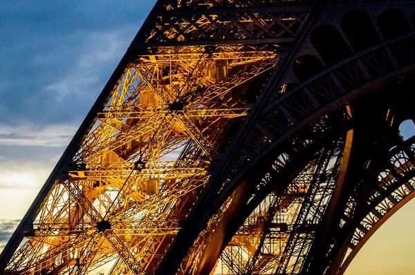 Finding a fresh way to capture a familiar subject can be a challenge, but this photographer rose to the occasion. This pic of a portion of the iconic 984-foot Eiffel Tower also exemplifies wonderful use of available lighting. Nikon D7000