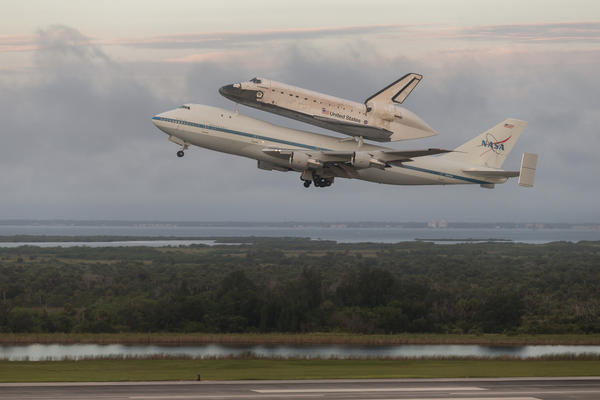 The space shuttle Endeavour takes to the skies after departure from NASA's Kennedy Space Center. (Reuters)
