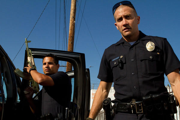 "Michael Pena and Jake Gyllenhaal play police partners in the film ""End of Watch."""
