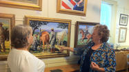 "Trish Suder has a painting in the Mansion House Art Gallery of a Confederate soldier during the Civil War giving water to an injured Union soldier. It is entitled ""He's My Brother."""