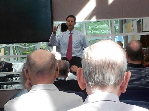 U.S. Rep. John Sarbanes talks to to members of the Howard County chapter of National Active and Retired Federal Employees at their monthly meeting on Wednesday at the East Columbia Branch Library.