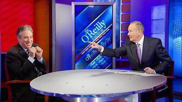 "Jon Stewart, left, sits down opposite Fox News host Bill O'Reilly on ""The O'Reilly Factor."""