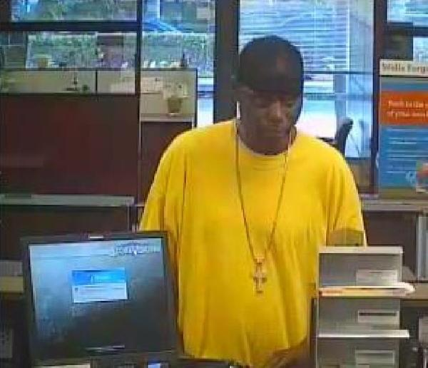 The FBI is looking for a man seen in surveillance pictures robbing a Wells Fargo bank in Sunrise