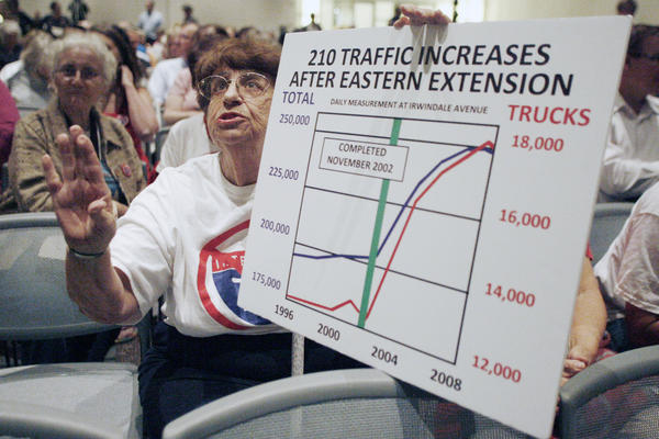 Mary Ann Parada shows a chart that was taken from the San Rafael Neighborhoods Association to Ara Najarian about traffic increase with the 210 freeway extension to the 215 freeway at the Pasadena Convention Center on Tuesday, September 18, 2012.