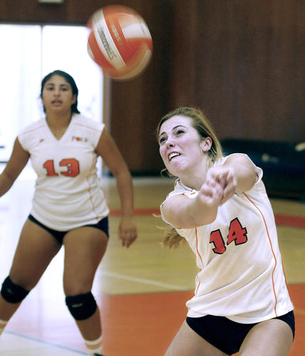 Pasadena Poly's #14 DeeDee Logan bumps a serve during home game vs. Chadwick in Prep League match in Pasadena on Wednesday, Sept. 19, 2012.  Poly lost the match. #13 is Olivia Treister.
