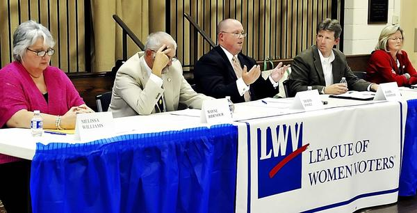 Washington County Board of Education candidate Travis Poole, center, gives his view as other candidates Melissa Williams, left, Wayne Ridenour, Justin Hartings and Donna Brightman listen at a forum held by the League of Women Voters at St. John's Episcopal Church Wednesday evening.