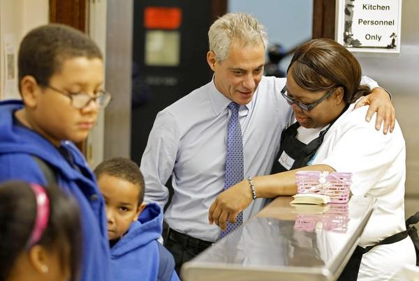 Mayor Rahm Emanuel, center, is considering an increase in Chicago taxes on cigarettes and entertainment to help close next year's budget gap.