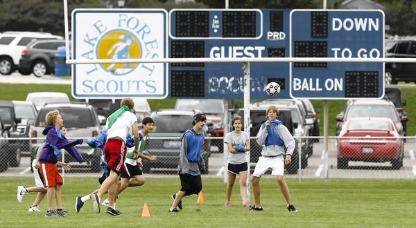 Students play soccer at Lake Forest High School on Wednesday, the first day back in the classroom for teachers, who tentatively agreed to a new contract early Wednesday.