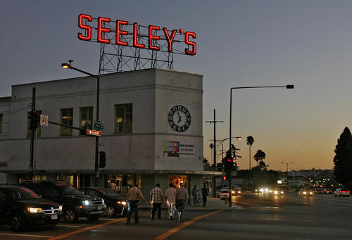 The illuminated Seeley's sign atop the Seeley Building in Glendale.