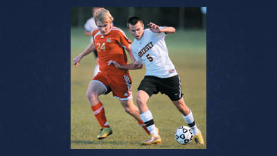 Somerset's Kody Williams keeps Shane Boyd of Bishop McCort away from the ball during the Eagles' home opener Wednesday. After two overtime periods, the game ended with neither team scoring.