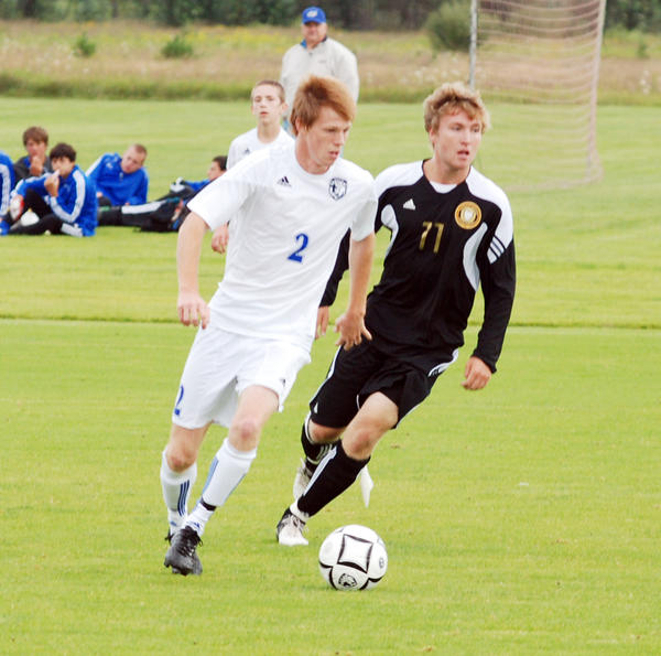 Burt Lake Northern Michigan Christian Academy senior Aaron Chatfield (left) tied the MHSAA state record for career goals at 172 as he had five goals Wednesday in the Eagles 5-1 win at Cheboygan.
