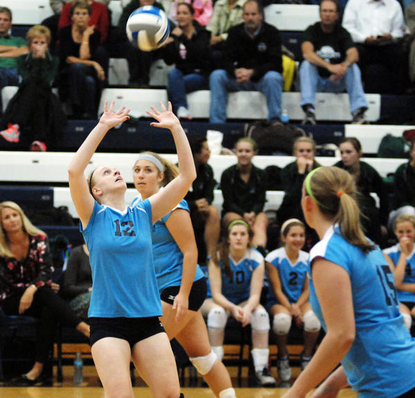 Petoskey senior setter Shannon Cosens (left) had 43 assists Wednesday as the Northmen defeated Alpena in three sets to improve to 20-2-2 overall, 5-1 league.