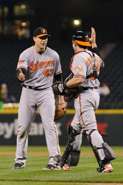 Baltimore Orioles relief pitcher Jim Johnson (43) and catcher Taylor Teagarden (31) react to defeating the Seattle Mariners in the 11th inning at Safeco Field.