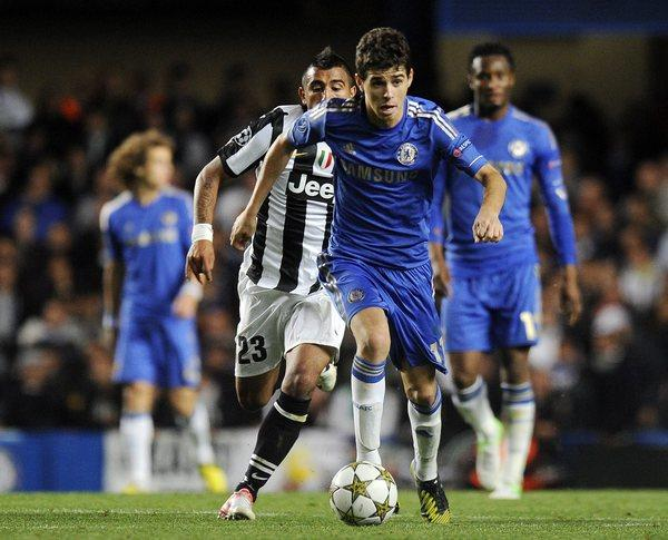 Chelsea's Oscar moves the ball ahead of Arturo Vidal of Juventus.