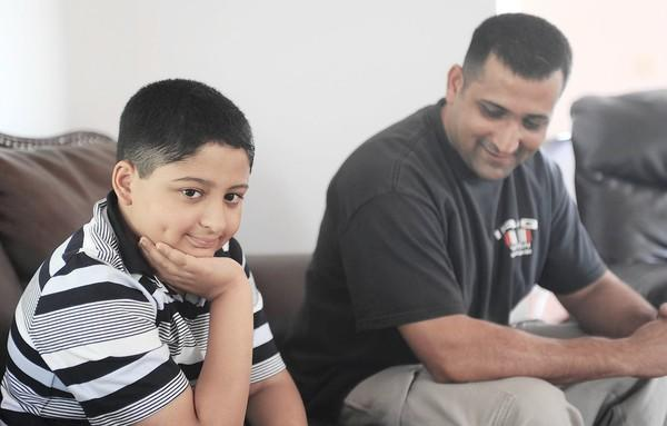Toseef Mughal, 9, of South Whitehall, nearly died of sepsis 7 months ago. He and his father, Shoukat Mughal, are in their home on Friday, September 14
