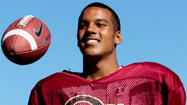 Oaks Christian can't help but smile along with QB Brandon Dawkins